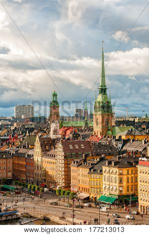 Scenic view to roofs of Gamla stan and Tyska kyrkan - German church - of Stockholm Sweden ay summer sunny day