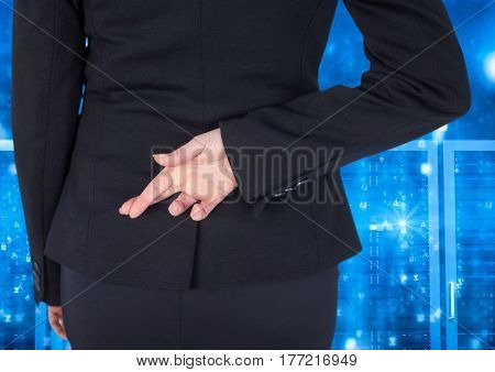 Digital composite of Businessman Standing Crossing her fingers and looking at Graphic against a blue background