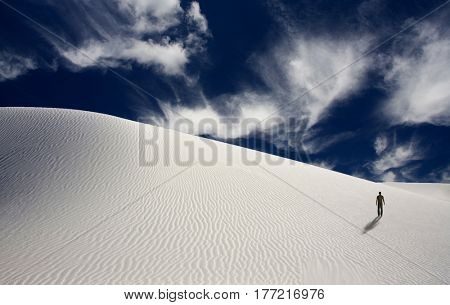 Lonely man in surreal white desert.   3d render.