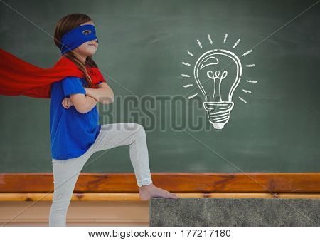 Digital composite of kid and blackboard with lightbulb against a black background