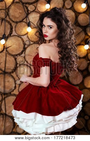 Brunette girl in a red dress at a party