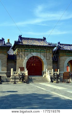 Old red wooden gate in The Temple of Heaven Beijing China. Chinese traditional designs (Qing dynasty style) It reflects imperial power