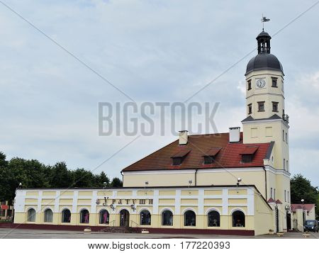 Nesvizh Belarus - August 1 2016: Nesvizh town hall is the monument of architecture of Belarus XVI-XVIII centuries. Located in the Central part of the town of Nesvizh in the square and includes the town hall and shopping arcades at the sides.