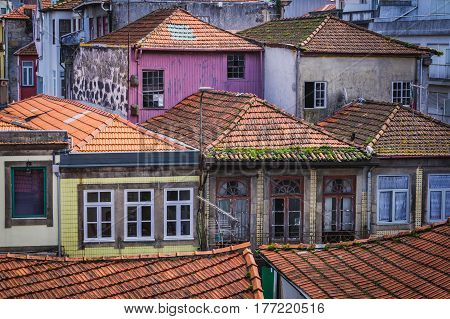 Red tiled roofs of old houses in Porto city Portugal