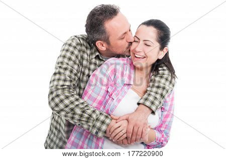 Handsome Male Embracing And Kissing His Girlfriend