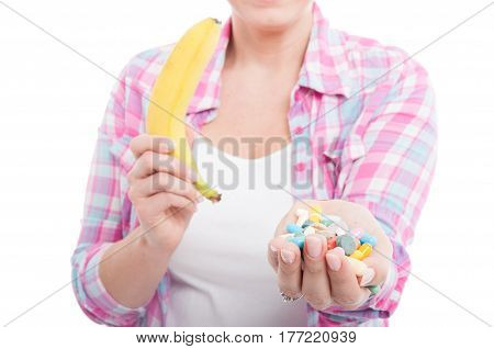 Woman Holding Banana And Tablet Pills