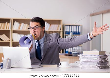 Angry businessman working in the office