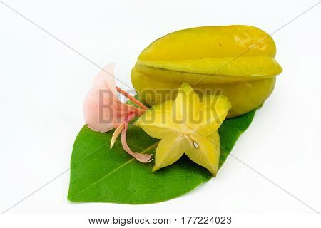 Starfruit isolated on white decorated with flowers and leafs