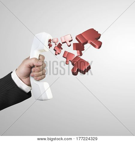 Hand Holding Telephone Handset With Thumbs Down Spraying Out