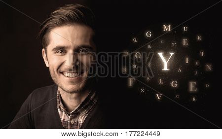 Close-up of handsome businessman with alphabet letters near him. Communication, information, intelligence concept