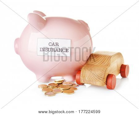 Piggy bank with wooden toy car on white background