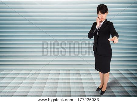 Digital composite of Businesswoman looking and pointing at camera against grey background