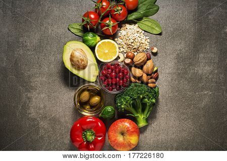 Selection of healthy food with vegetable and fruits. Healthy diet foods for heart cholesterol and diabetes.