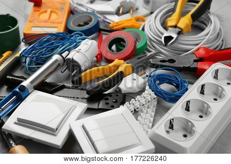 Electrician tools on grey background, closeup