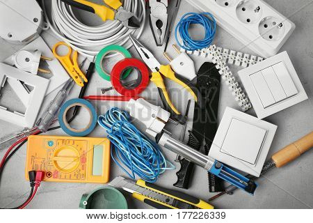 Electrician tools on grey background