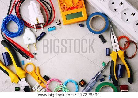 Different electrical tools on light background, top view
