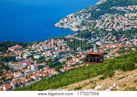 view from the top of mount Srdj to the city of Dubrovnik with a cable car moving down, Croatia