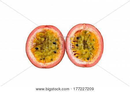Passionfruit isolated on white decorated with frangipani flowers