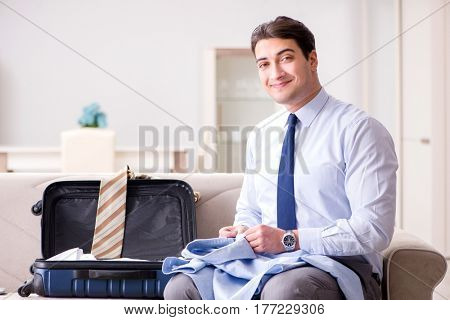 Businessman preparing for the business trip