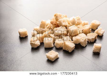 Croutons of wheaten bread on grey background