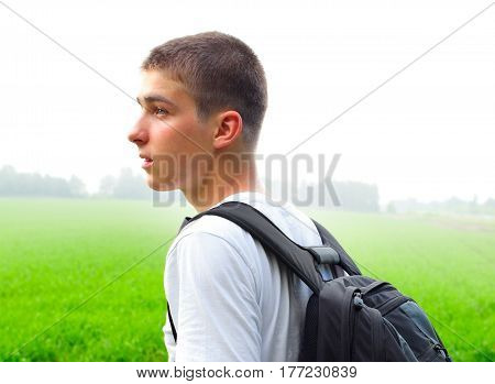 Young Man with Knapsack in the Summer Field