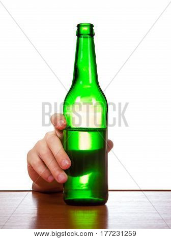 Person hold a Bottle of the Beer on the Table closeup