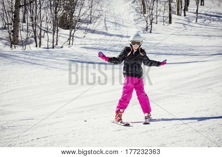 Young skier learning to ski downhill
