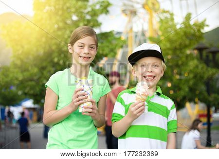 Kids eating ice cream and treats at the carnival