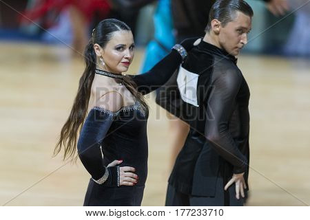 Minsk Belarus-February 18 2017: Pro-Am Couple of Pavlo Vinichenko and Olena Lutskiv Perform Pro-Am Super Cup International Latin Program on WDSF Minsk Open Dance Festival-2017 Championship in February 18 2017 in Minsk Belarus.