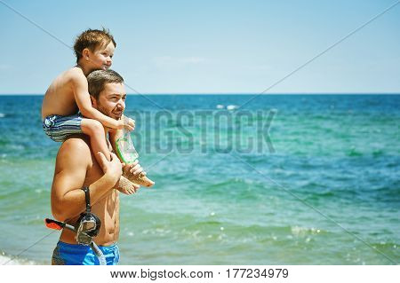 father playing with son at sea .The concept of father's day