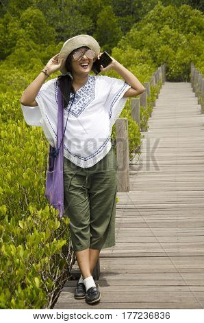 Travelers Thai Women Portrait For Take Photo On Wooden Bridge For Travel And Visit Golden Mangrove F