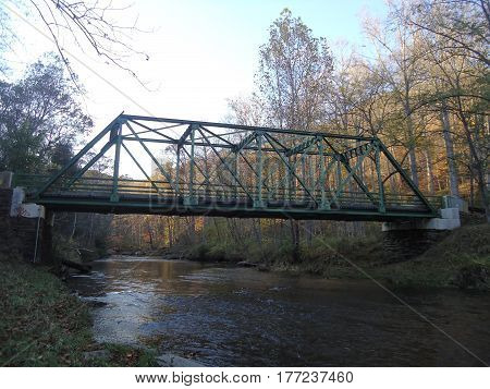 Bridge/Trestle spanning a deep and wide ravine filled with water.