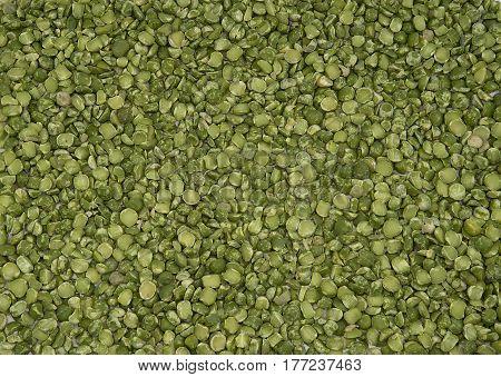 Dry split green peas texture background carpet