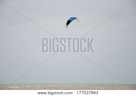 Thai People Playing Kite Surf With Wind And Wave On The Sea