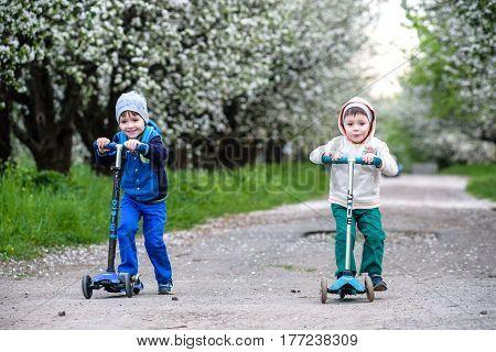Kiev, Ukraine - March 30, 2016: Two Boys Kids Riding On Scooter