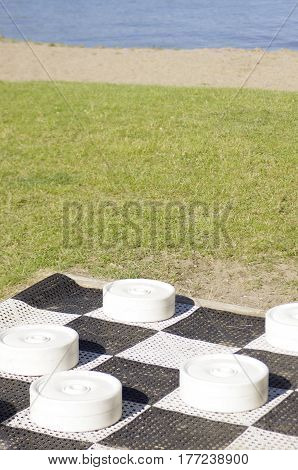 oversized black and white checkers game at the beach