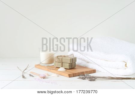 Spa and welness products on light wooden background