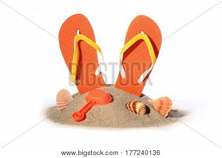 Flip-flops in sand isolated over white background.