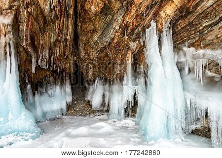 Narrow Grotto And Splash Of Ice On Rock
