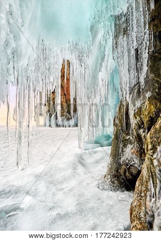 Sharp Icicles Hanging On Coastal Rock In Early Morning