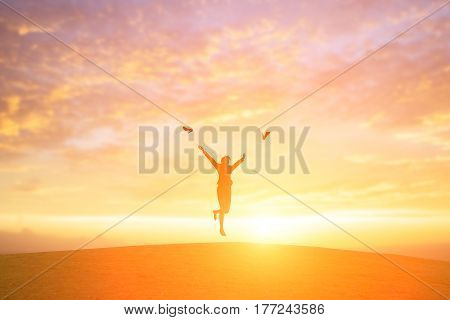silhouette of business woman throw high heels in the air