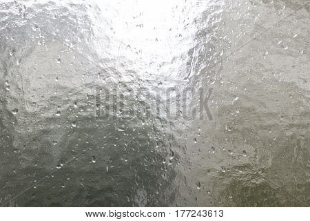structural glass pane with rain drops for backgrounds and compositions