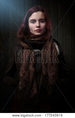 Portrait Of A Strict Looking Woman With Leather Jacket
