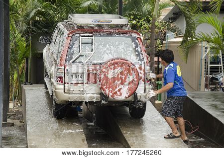 Thai People Workers Cleaning And Washing Car At Local Carwash Station