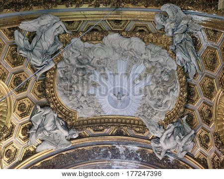ROME, ITALY - SEPTEMBER 02: Holy spirit and angels, stucco decoration on the ceiling of chapel of Our Lady of Miracles, Church San Giacomo in Augusta in Rome, Italy on September 02, 2016.