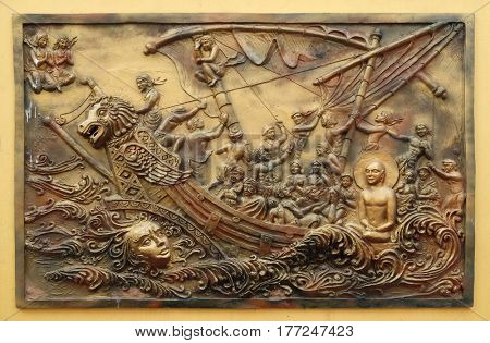 KOLKATA, INDIA - FEBRUARY 09, 2016: Soul itself is the strongest power; Sudamstra, a serpent-prince, creates a heavy storm in the river, but fails, bass relief on the wall of Jain Temple in Kolkata.