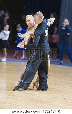 Minsk Belarus-February 18 2017: Pro-Am Couple of Ivan Miskevich and Svetlana Rodina Performs Pro-Am Super Cup International Latin Program on WDSF Minsk Open Dance Festival-2017 Championship in February 18 2017 in Minsk Belarus.