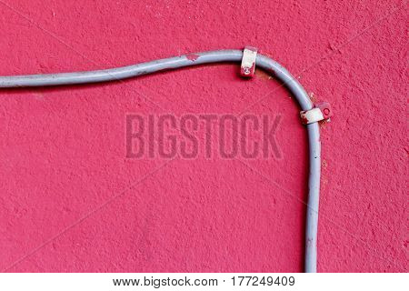 Ethernet cable attached to the wall. Abstract background