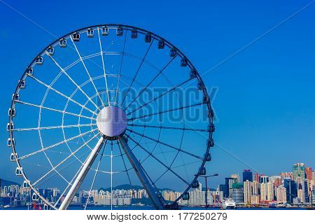 The Hong Kong observation (ferris) wheel on the Central overlooking Victoria harbour with blue sky as a background and copy space