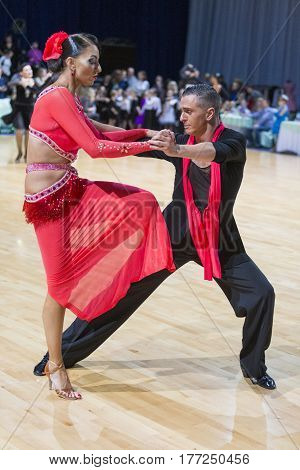 Minsk Belarus-February 18 2017: Pro-Am Dance Couple Performs Pro-Am Super Cup International Latin Program on WDSF Minsk Open Dance Festival-2017 Championship in February 18 2017 in Minsk Belarus.
